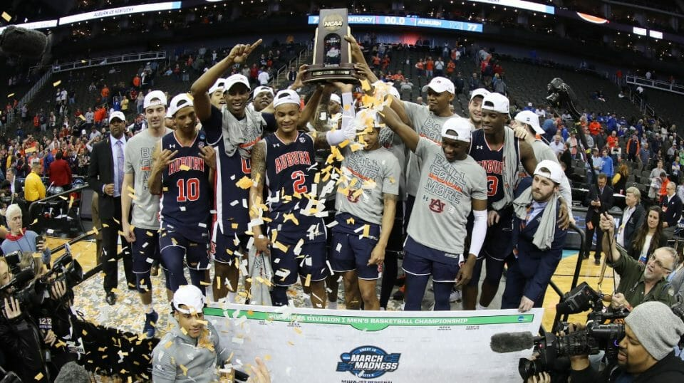 The Auburn Tigers celebrate with the trophy after defeating the Kentucky Wildcats 77-71 in overtime during the NCAA Tournament Midwest Regional at Sprint Center in Kansas City on March 31, 2019.