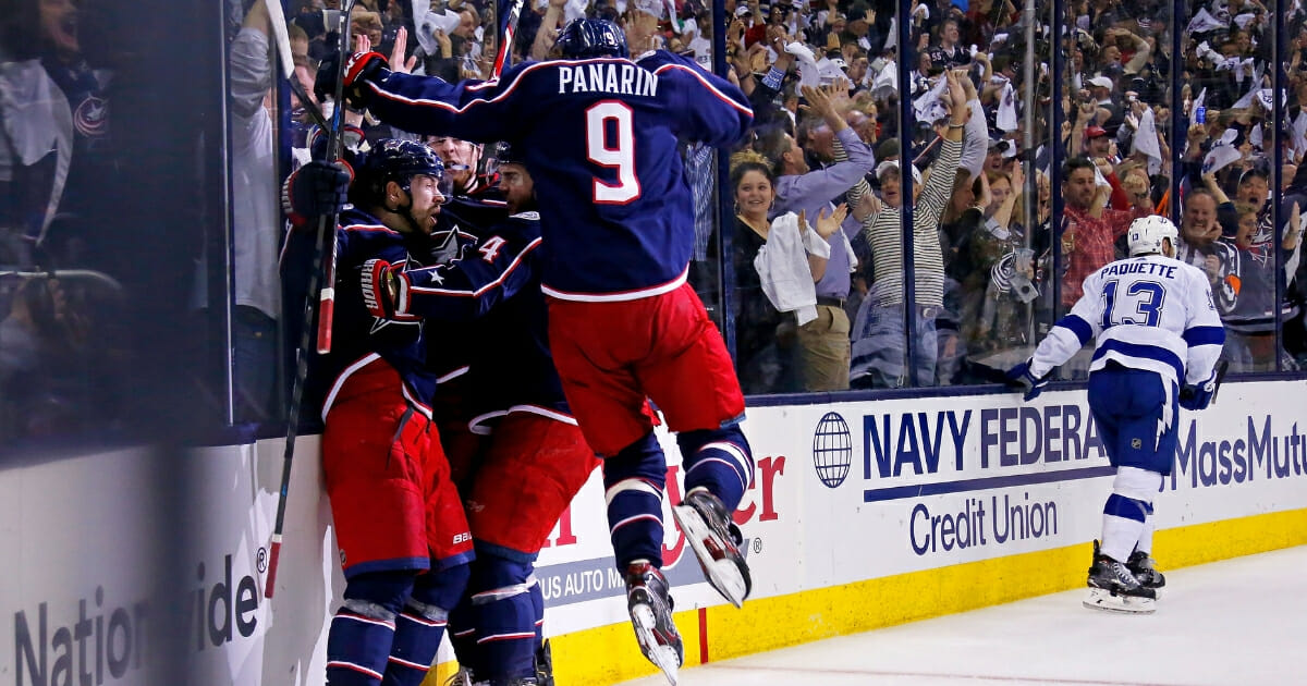 Oliver Bjorkstrand of the Columbus Blue Jackets is congratulated by his teammates after scoring a goal against the Tampa Bay Lightning on April 16, 2019, at Nationwide Arena.