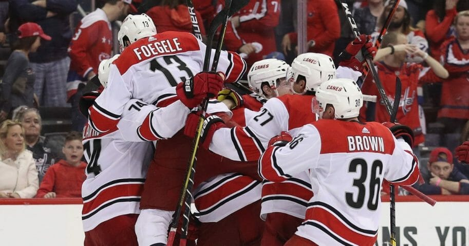 The Carolina Hurricanes celebrate their victory over the Washington Capitals in Game 7 of the Eastern Conference First Round during the 2019 NHL Stanley Cup Playoffs at the Capital One Arena on April 24, 2019, in Washington, D.C.