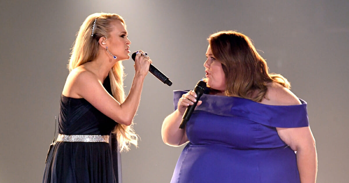 Carrie Underwood and Chrissy Metz perform onstage during the 54th Academy of Country Music Awards at MGM Grand Garden Arena on April 7, 2019, in Las Vegas, Nevada.