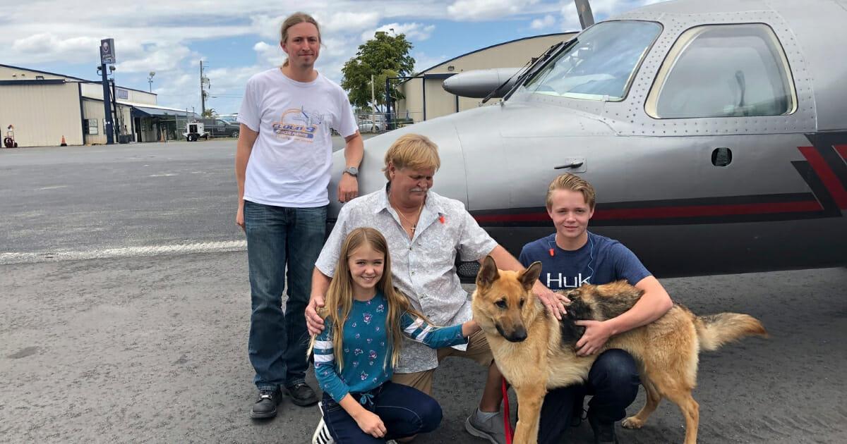 Cedar the German Shepherd, family, and pilot