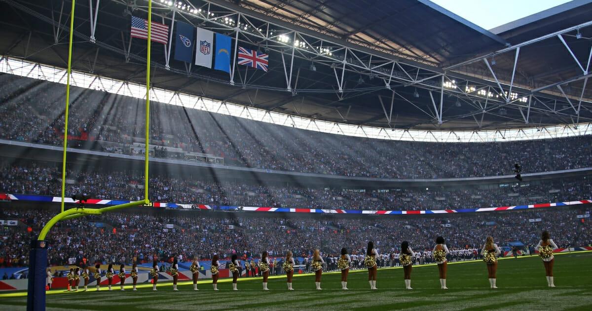 NFL cheerleaders on the field at Wembley Stadium in London.