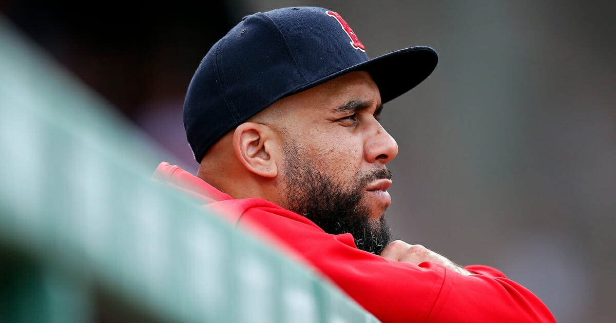 Boston Red Sox pitcher David Price watches from the dugout during a game against the Baltimore Orioles on April 13, 2019, in Boston.