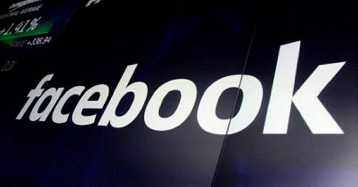 The logo for Facebook appears on screens at the Nasdaq MarketSite, in New York's Times Square in a file photo from 2018.
