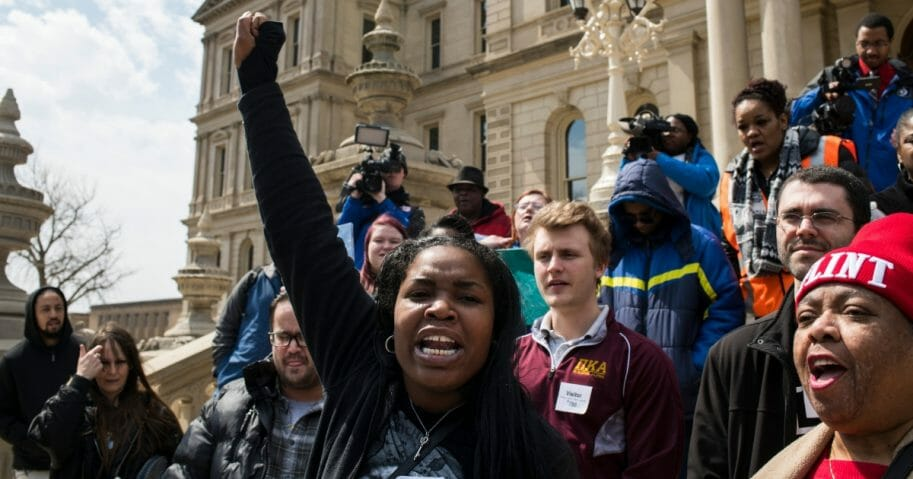 Ariana Hawk of Flint, Michigan, leads a chant during a protest on the steps of the Michigan State Capitol on April 11, 2018, in Lansing, Michigan.