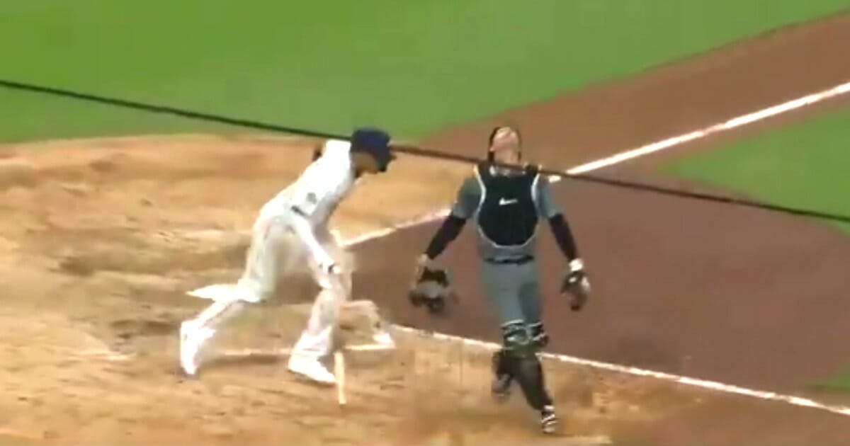 The Padres' Manny Machado was called out for interference against the Diamondbacks when he made contact with catcher John Ryan Murphy upon leaving the box.