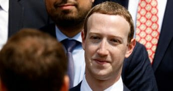 Facebook CEO Mark Zuckerberg listens to French President Emmanuel Macron at the Elysee Palace in Paris on May 23, 2018.