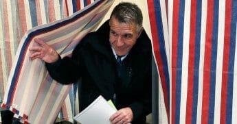 Republican Vermont Gov. Phil Scott leaves the ballot booth in Berlin, Vt., on Nov. 6, 2018.