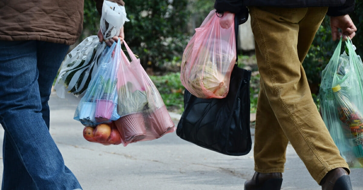 Shoppers carrying plastic bags.