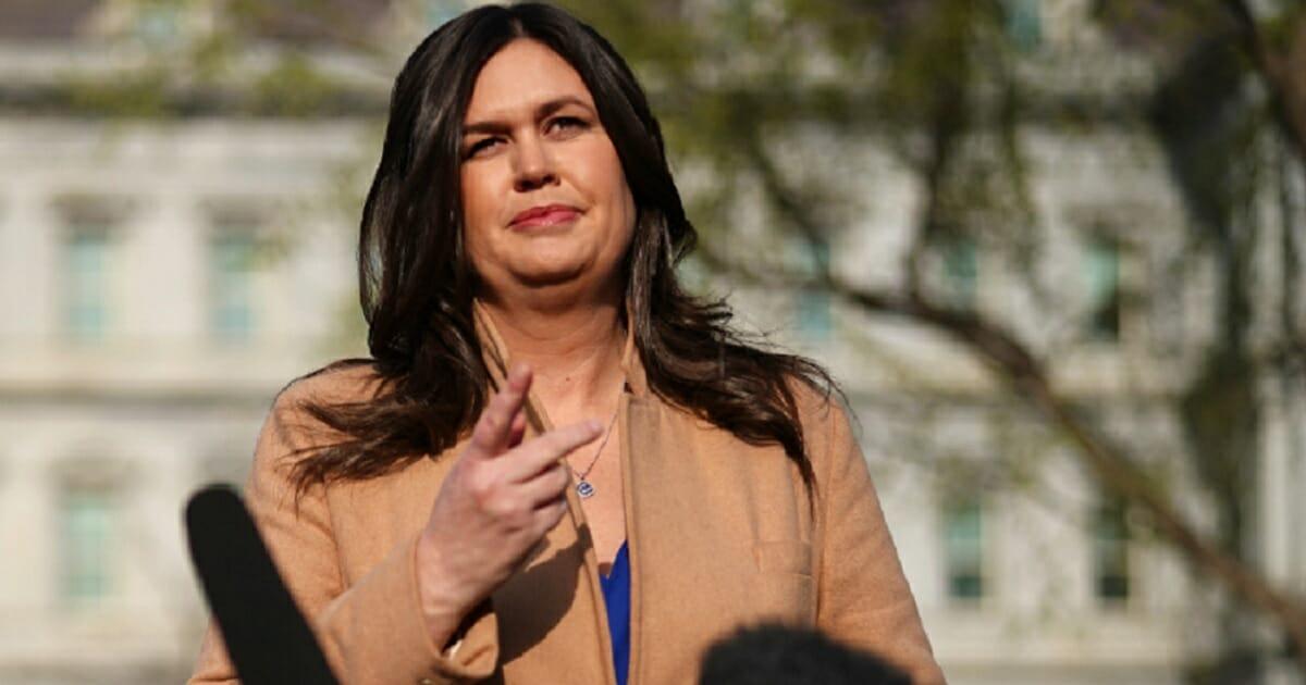 White House press secretary talks to reporters outside the White House on April 4.