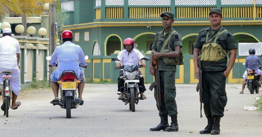 Sri Lankan security personnel stand guard outside Mohideen Meththai Grand Jumma Mosque in Kattankudy on April 26, 2019.