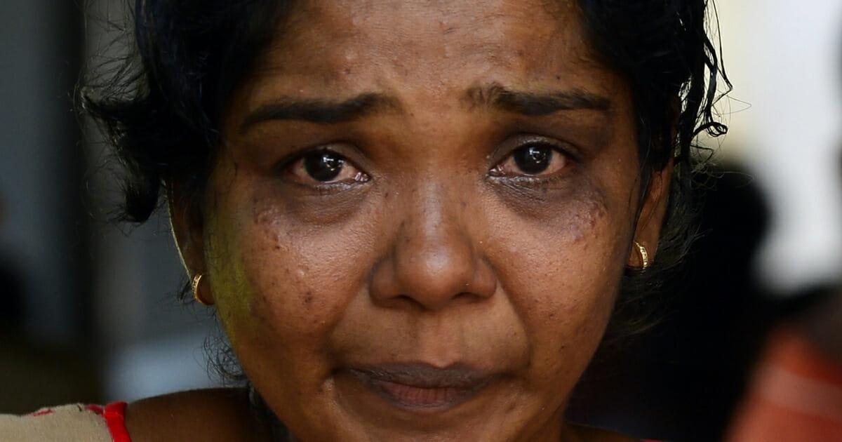 A Sri Lankan relative of a bomb blast victim weeps at a morgue in Colombo on April 22, 2019, as people gather hoping to identify loved ones missing or killed in the Easter Sunday attacks on churches and hotels.
