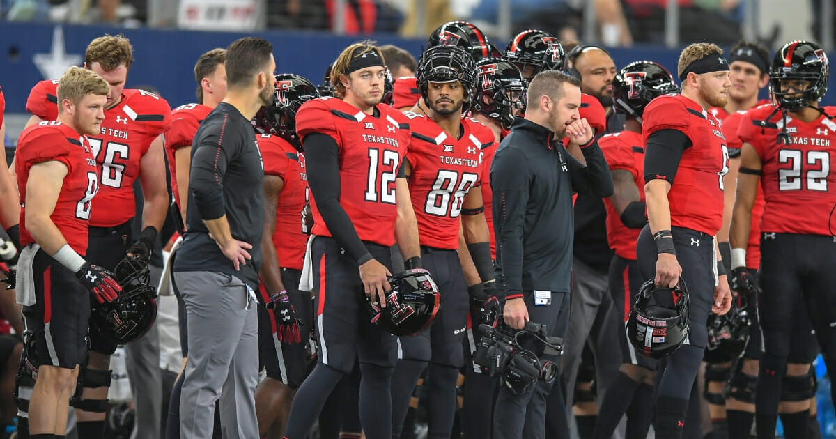 Texas Tech Red Raiders watch during their game November 24, 2018, at AT&T Stadium in Arlington, Texas.