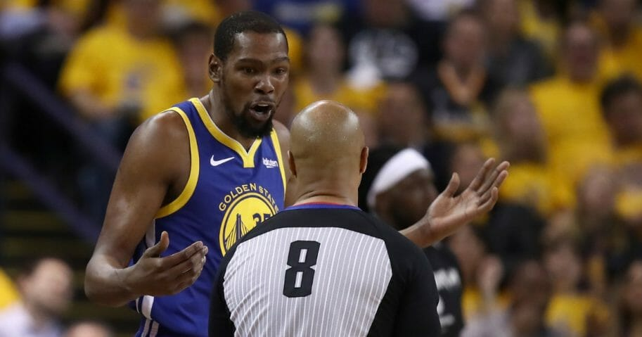 Kevin Durant of the Golden State Warriors questions a call by referee Marc Davis on Wednesday during Game 5 of the NBA Western Conference Playoffs at Oracle Arena in Oakland.