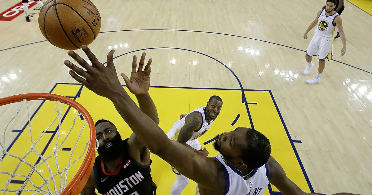 Kevin Durant of the Golden State Warriors blocks a shot by the Houston Rockets' James Harden.