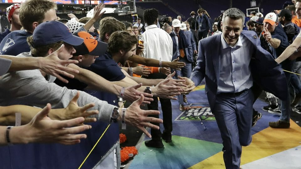 Virginia head coach Tony Bennett celebrates with fans after the championship game against Texas Tech in the Final Four NCAA college basketball tournament, Monday, April 8, 2019, in Minneapolis. Virginia won 85-77 in overtime.