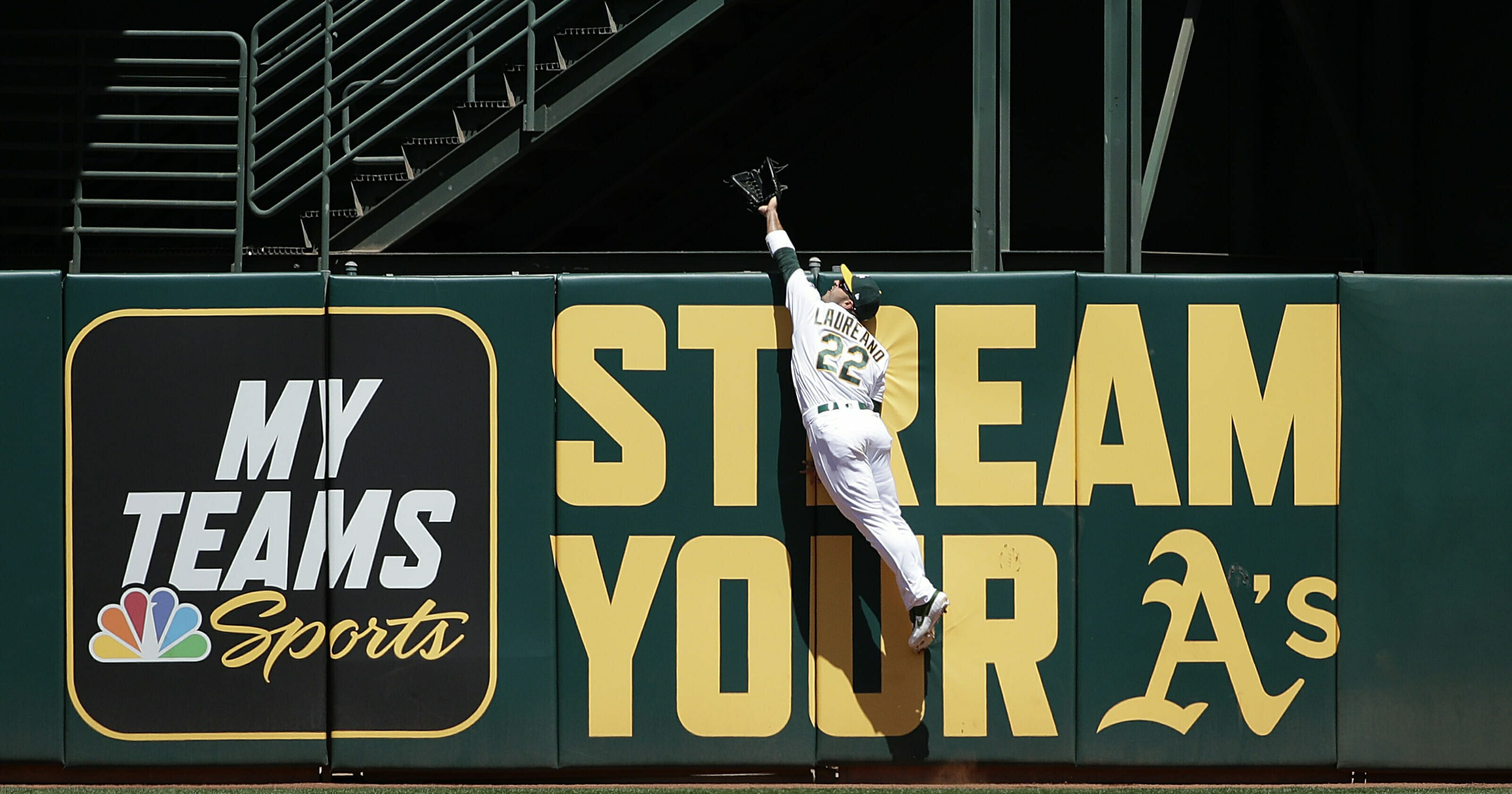 Oakland Athletics center fielder Ramon Laureano jumps to catch a fly ball hit by Toronto Blue Jays' Teoscar Hernandez during the second inning of a baseball game in Oakland, Calif., Sunday, April 21, 2019.