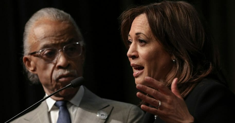 Rev. Al Sharpton looks on as Democratic presidential candidate U.S. Sen. Kamala Harris (D-CA) speaks at the National Action Network's annual convention.