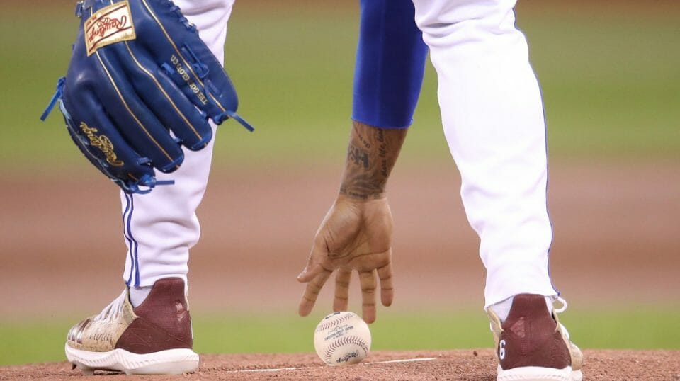 Marcus Stroman of the Toronto Blue Jays picks up the baseball on the rubber as he takes the mound and gets ready to pitch in the first inning during MLB game action against the Tampa Bay Rays at Rogers Centre on April 14, 2019 in Toronto.