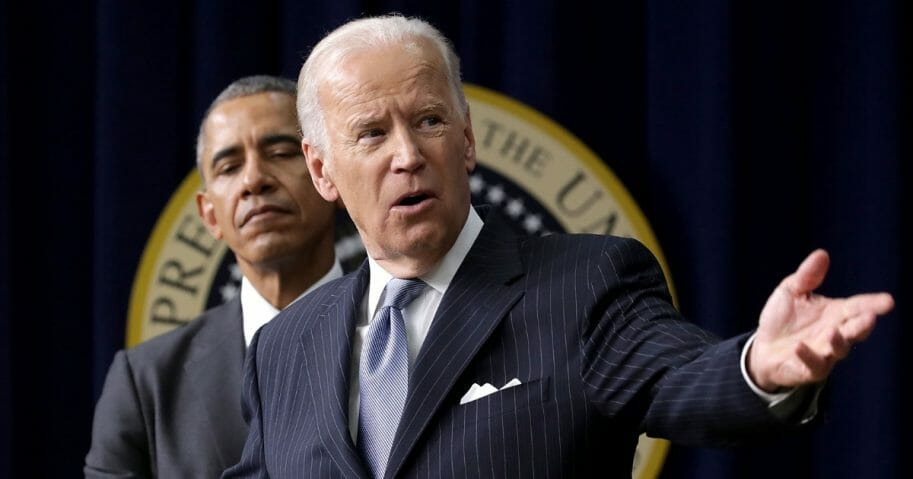 President Barack Obama (left) listens to Vice President Joe Biden deliver remarks.