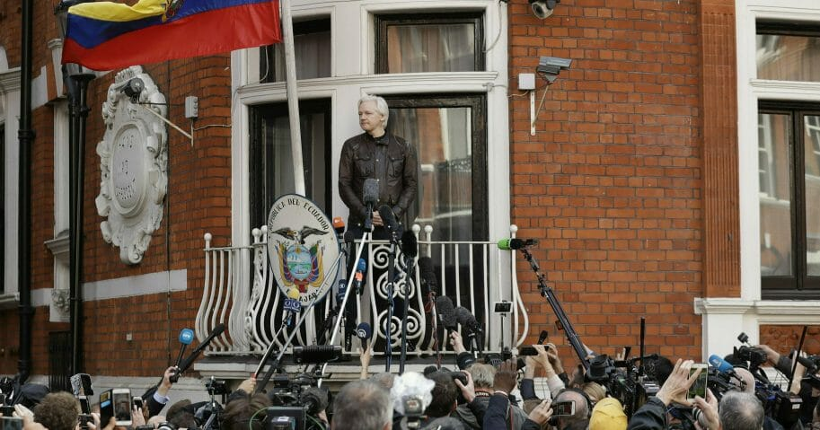 WikiLeaks founder Julian Assange looks out from the balcony of the Ecuadorian embassy May 19, 2017.