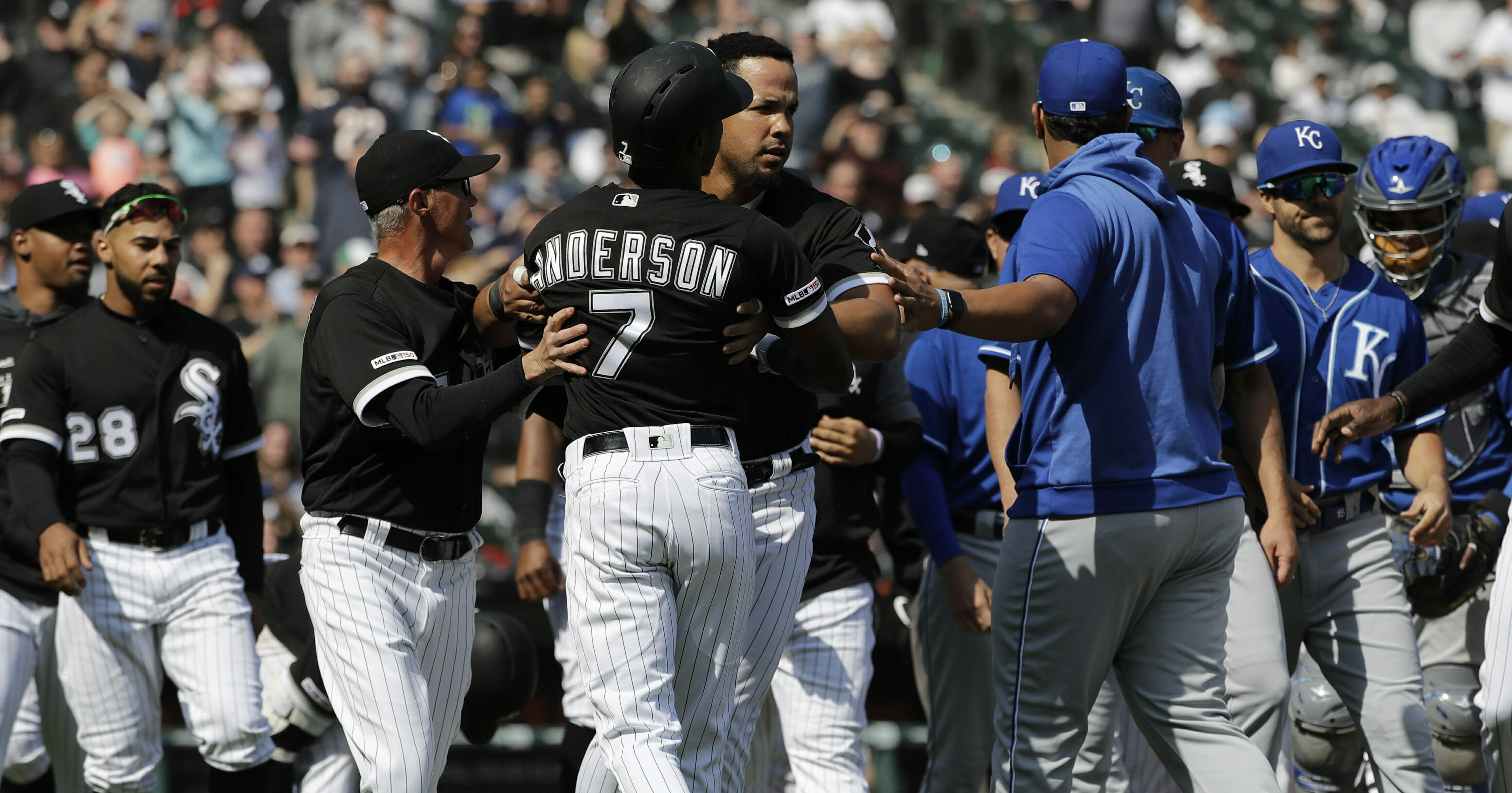 Chicago White Sox's Tim Anderson is restrained by Jose Abreu after he was hit by a pitch from the Kansas City Royals, as benches cleared during the sixth inning of a baseball game in Chicago, Wednesday, April 17, 2019.