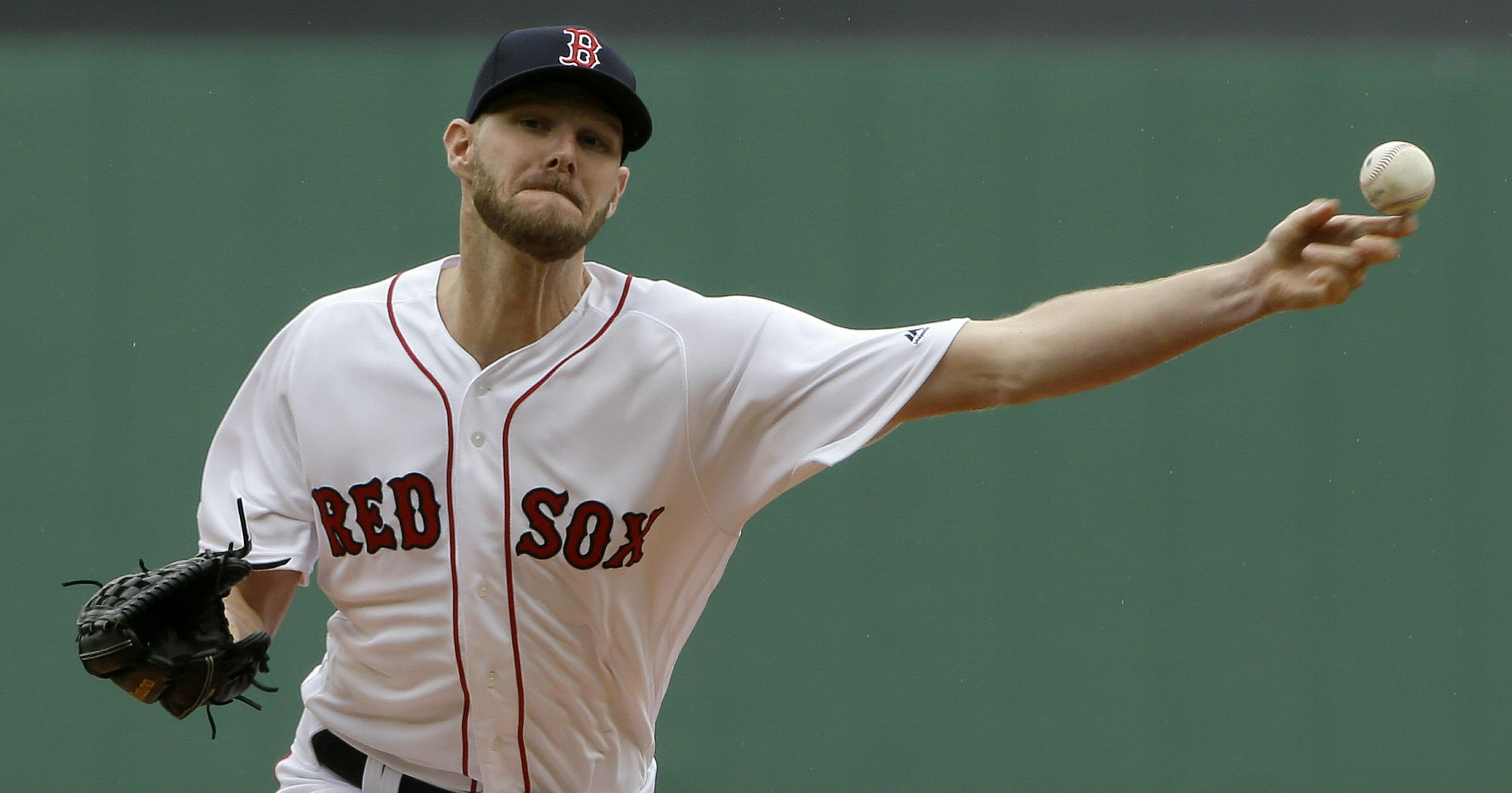 Boston Red Sox's Chris Sale delivers a pitch against the Tampa Bay Rays during the first inning of a baseball game at Fenway Park, Sunday, April 28, 2019, in Boston.