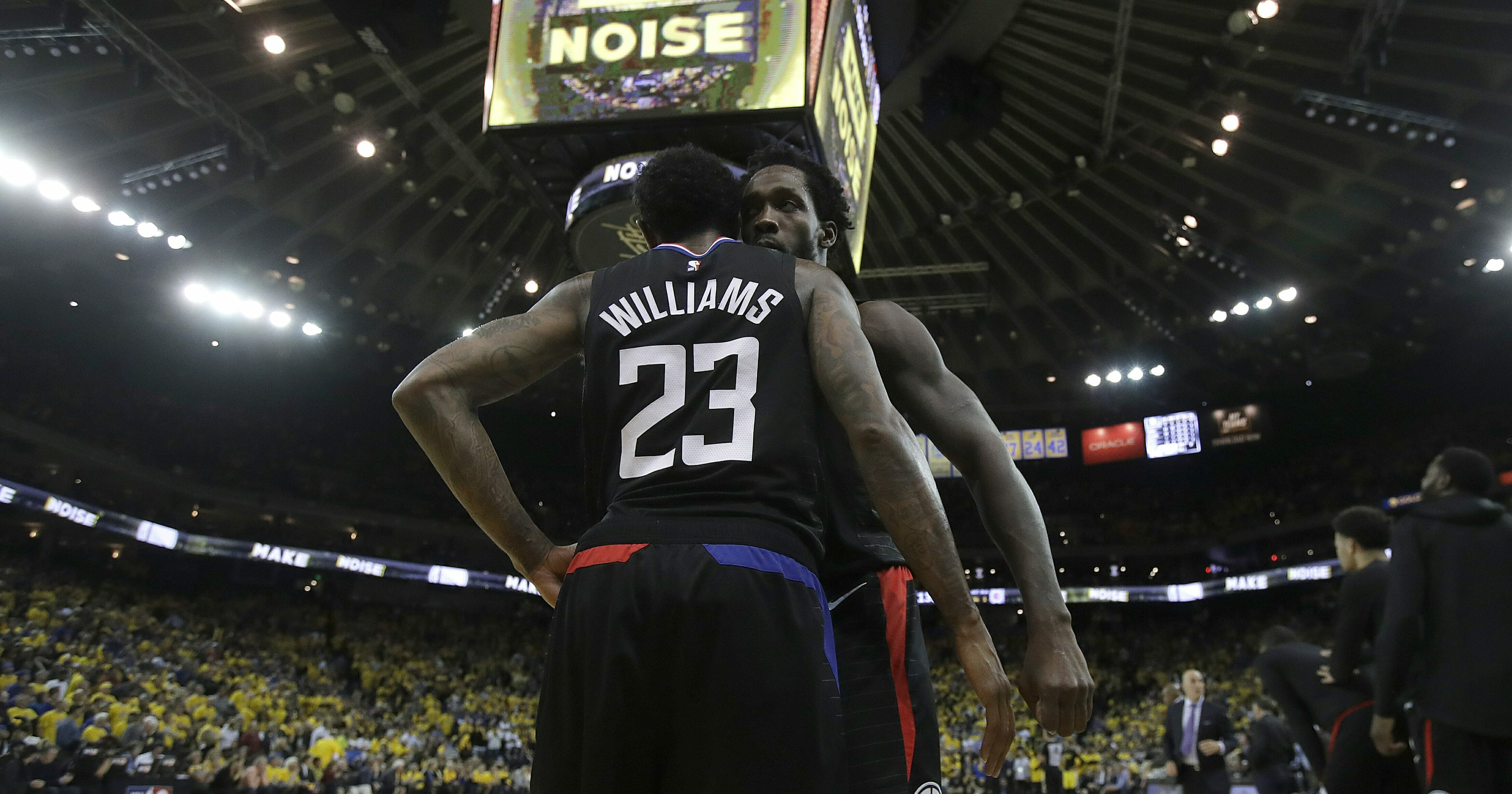 Los Angeles Clippers guard Lou Williams celebrates with Patrick Beverley during the second half of Game 2 of a first-round NBA basketball playoff series against the Golden State Warriors in Oakland, Calif., Monday, April 15, 2019.