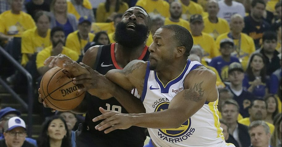 Houston Rockets guard James Harden, left, is fouled by Golden State Warriors guard Andre Iguodala.