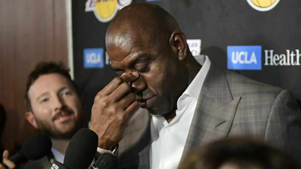 Magic Johnson wipes his eyes as he speaks to reporters prior to the Los Angeles Lakers game against the Portland Trail Blazers on April 9, 2019.