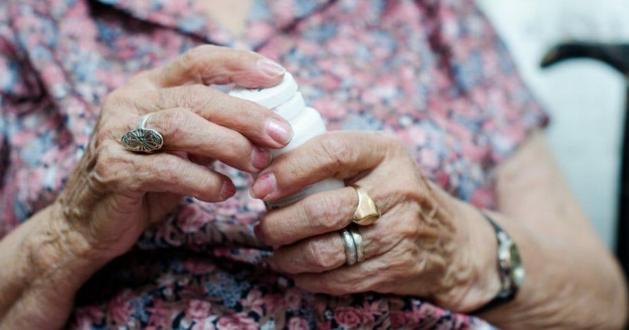 Elderly woman taking a prescription.