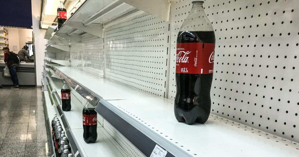 Empty shelves in supermarket because of price controls.