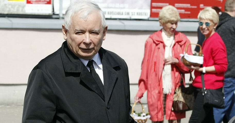 Jaroslaw Kaczynski, the leader of Poland's conservative ruling party, takes part in a Polish tradition of taking a basket to church for a blessing in Warsaw on Saturday, April 20, 2019.