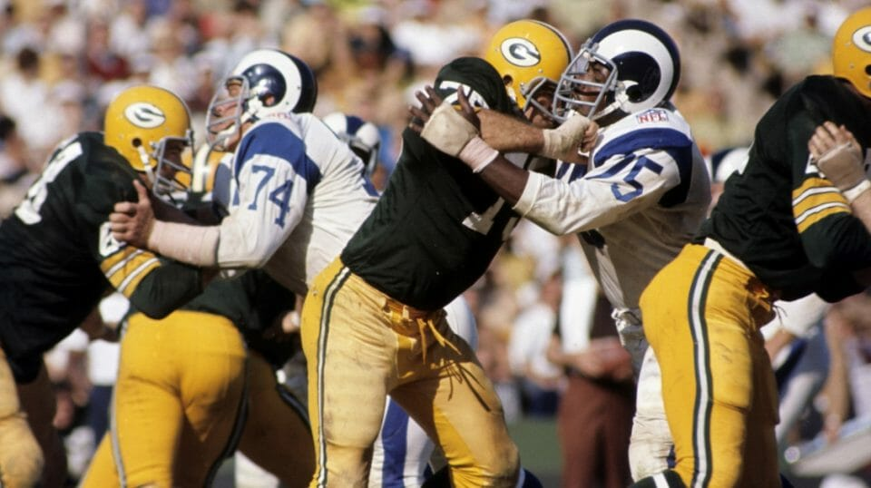 Two Hall of Famers, Los Angeles Rams defensive end Deacon Jones and Green Bay Packers tackle Forrest Gregg, battle it out during a 34-21 Rams victory on Oct. 19, 1969, at the Los Angeles Memorial Coliseum in Los Angeles.