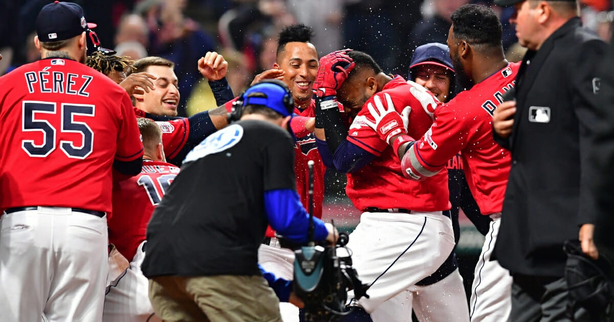 Carlos Santana of the Cleveland Indians celebrates as he rounds the bases after hitting a walk-off solo home run during the ninth inning against the Toronto Blue Jays at Progressive Field on April 5, 2019 in Cleveland.