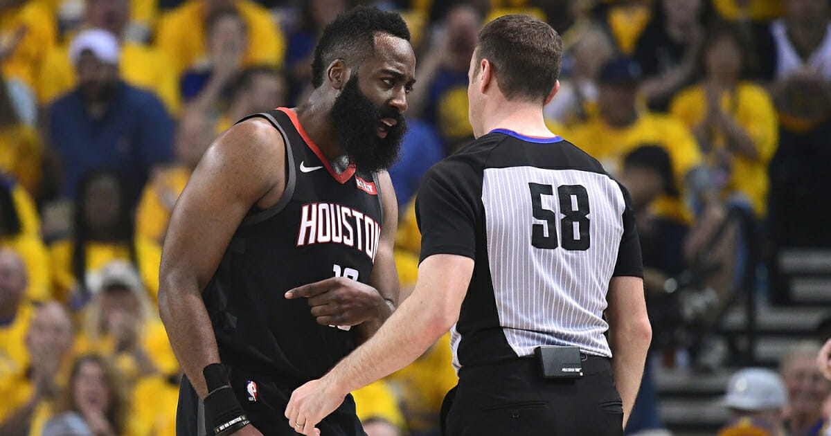 James Harden of the Houston Rockets complains over a foul call on him against the Golden State Warriors to referee Josh Tiven during Game One of the Second Round of the 2019 NBA Western Conference Playoffs at ORACLE Arena on April 28, 2019 in Oakland, California.