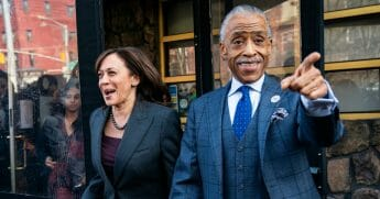 2020 Democratic presidential candidate Sen. Kamala Harris and Rev. Al Sharpton exit after having lunch at Sylvia's Restaurant in Harlem.
