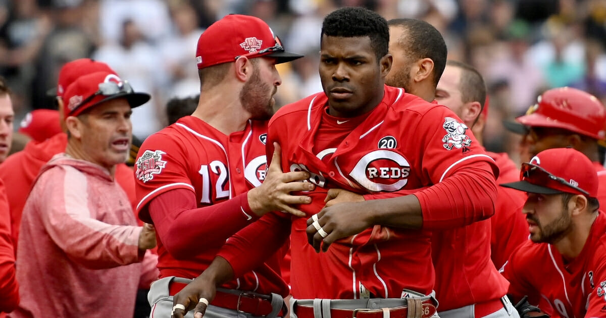 Yasiel Puig of the Cincinnati Reds is restrained after benches clear in the fourth inning during the game against the Pittsburgh Pirates at PNC Park on April 7, 2019 in Pittsburgh.