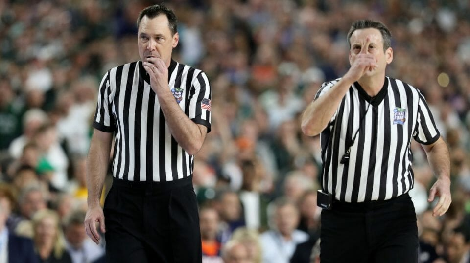 Referees react in the second half during the 2019 NCAA Final Four semifinal between the Auburn Tigers and the Virginia Cavaliers at U.S. Bank Stadium on April 6, 2019.