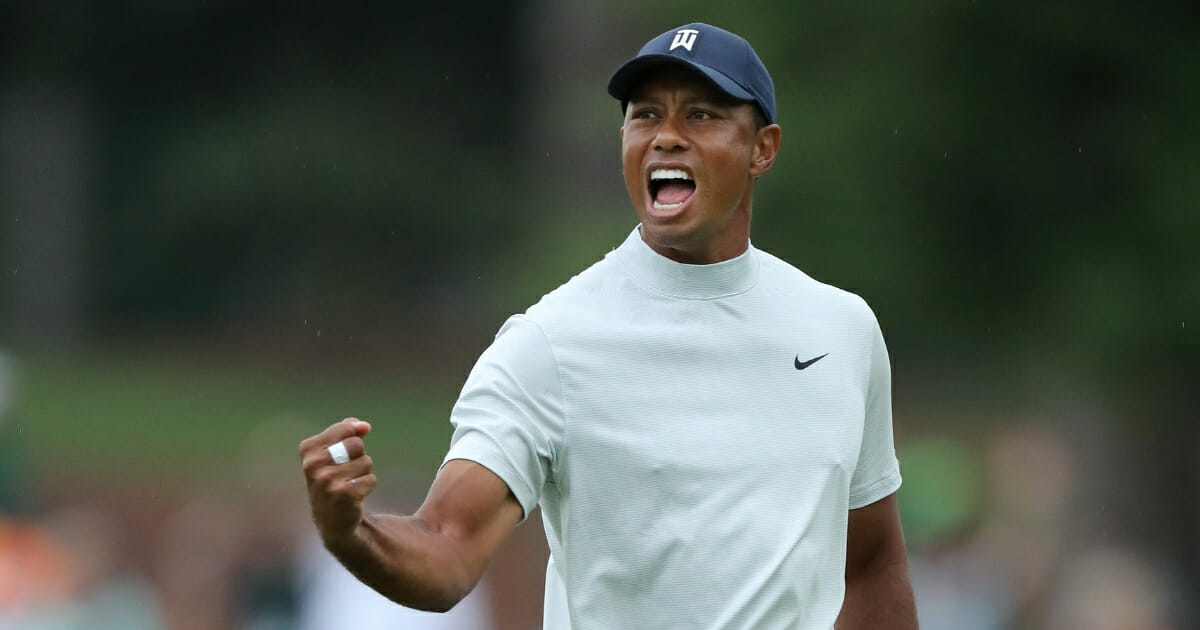 Tiger Woods of the United States celebrates after making a putt for birdie on the 15th green during the second round of the Masters at Augusta National Golf Club on April 12, 2019 in Augusta, Georgia.