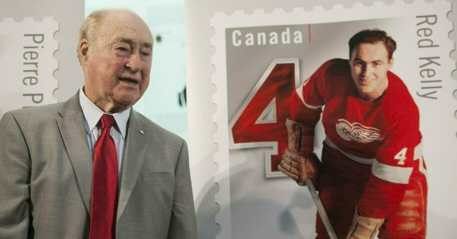Red Kelly stands beside his Canadian stamp during the Feb 1, 2019, unveiling of a series featuring defensemen from the original six NHL teams at the Hockey Hall of Fame in Toronto.