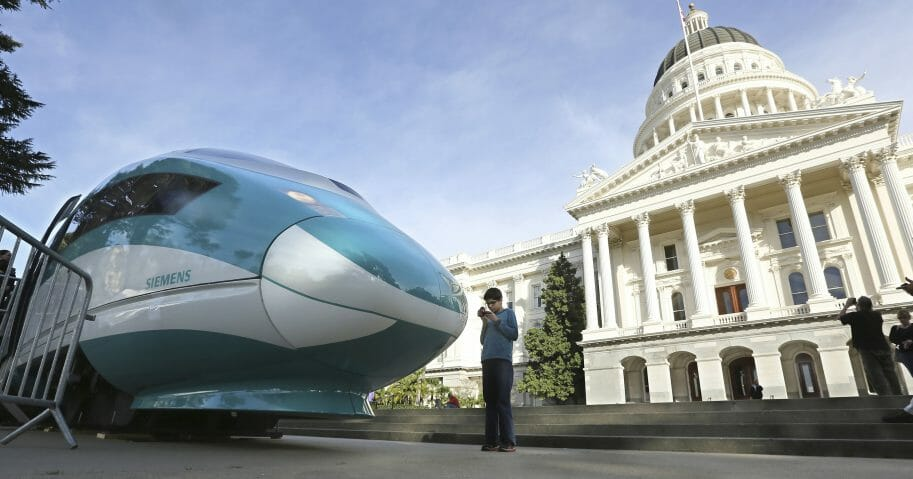 In this Feb. 26, 2015, file photo, a full-scale mock-up of a high-speed train is displayed at the Capitol in Sacramento, California. The Trump administration canceled nearly $1 billion in federal money for California's high-speed rail project on Thursday, further throwing into question the future of the ambitious plan to connect Los Angeles and San Francisco. (Rich Pedroncelli / AP Photo)