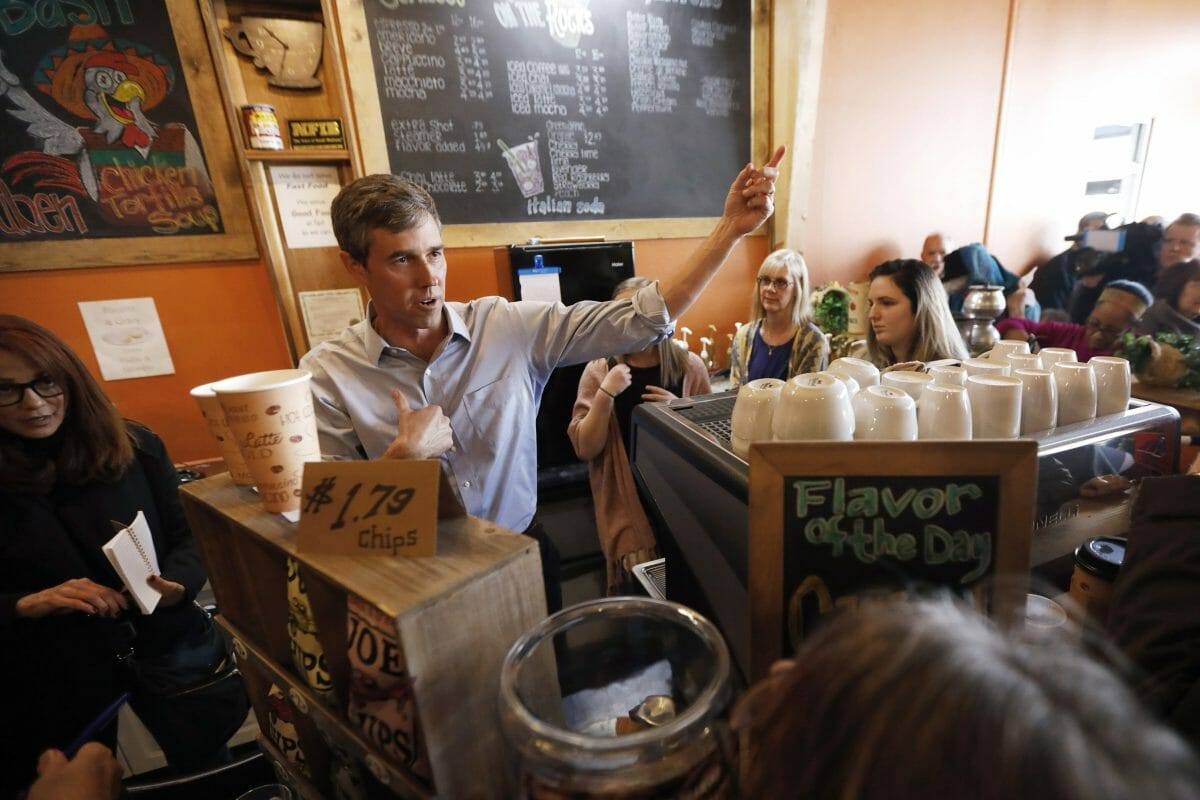 Democratic presidential candidate former Texas congressman Beto O'Rourke greets audience members during a stop at the Central Park Coffee Company in Mount Pleasant, Iowa.
