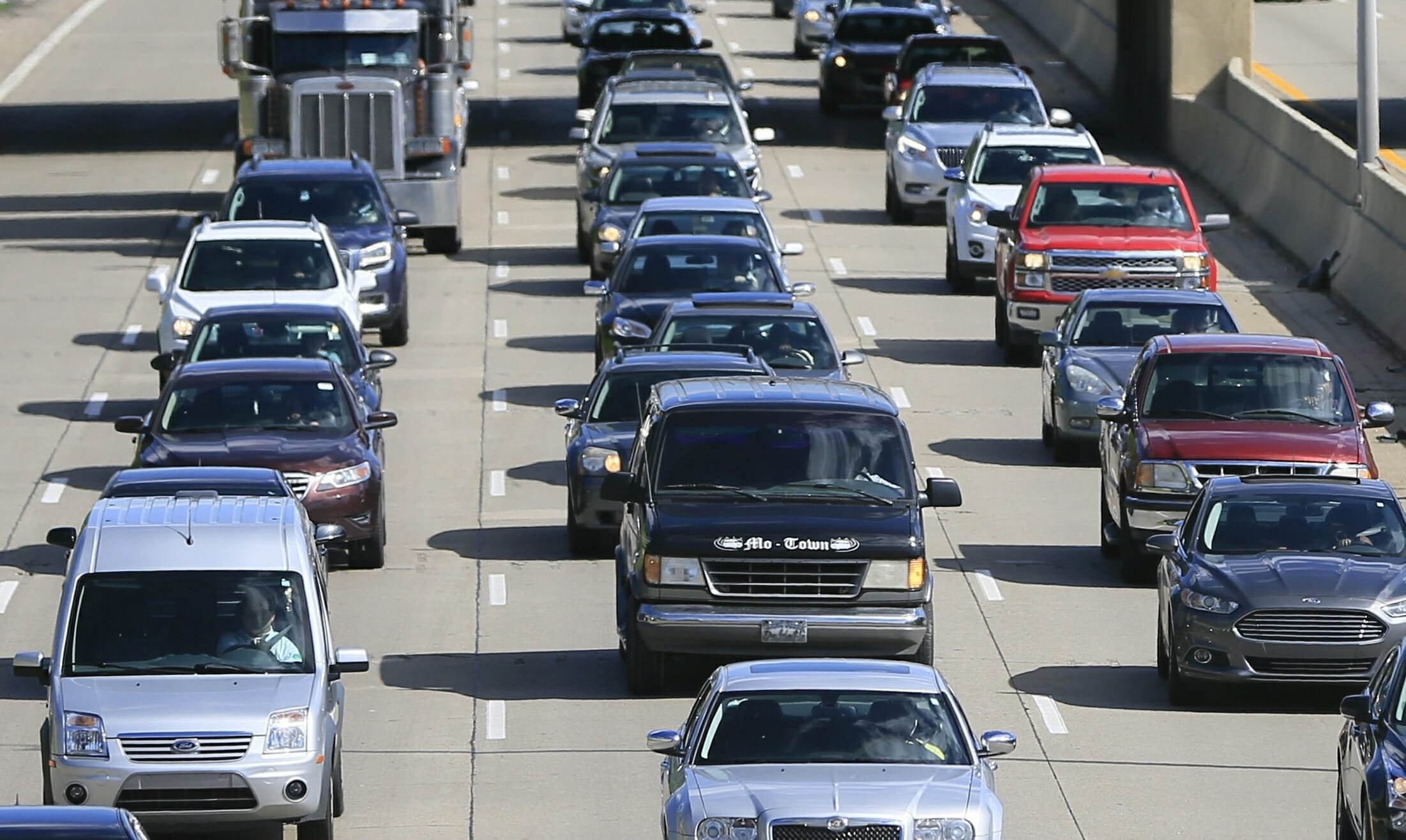 In a June 23, 2015, file photo, traffic heads north along the Lodge freeway in Detroit. Michigan.