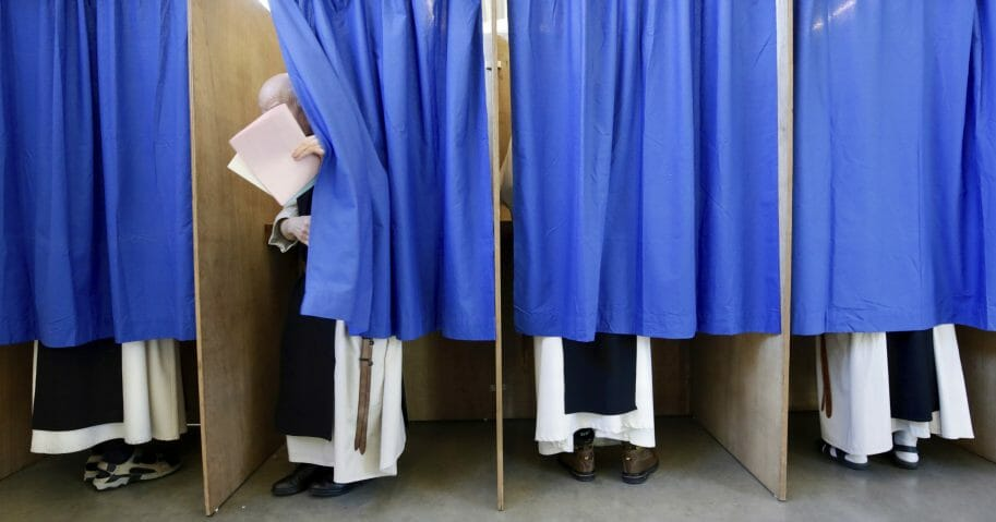 Curtained polling booths.
