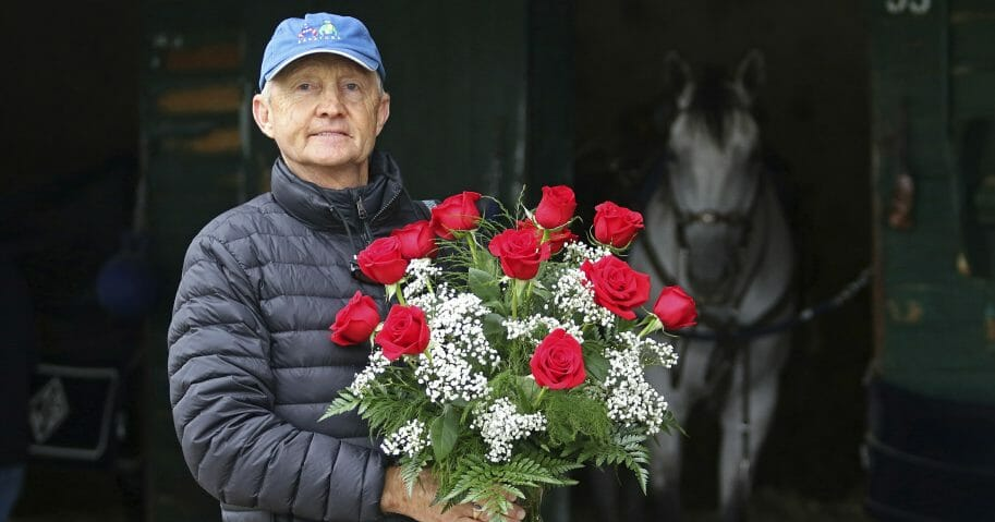 Jason Servis, trainer of Maximum Security, who was disqualified from first place in the Kentucky Derby, stands outside his barn at Monmouth Park on May 9, 2019 with a dozen roses.
