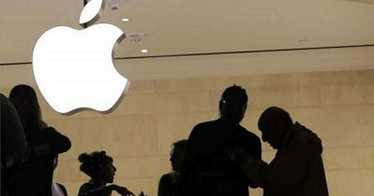 Customers enter the Apple store in New York City last year.