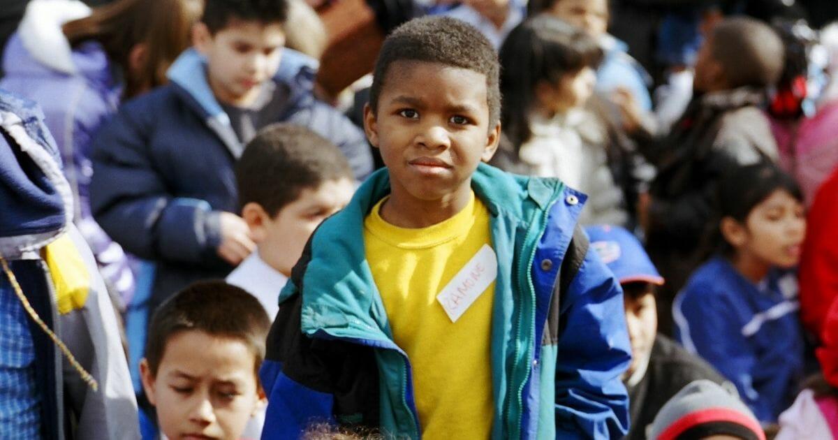 A boy in a crowd.