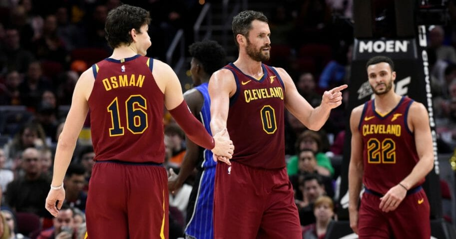 From left, Cedi Osman, Kevin Love and Larry Nance Jr. of the Cleveland Cavaliers celebrate after a play against the Orlando Magic at Quicken Loans Arena on March 3, 2019.