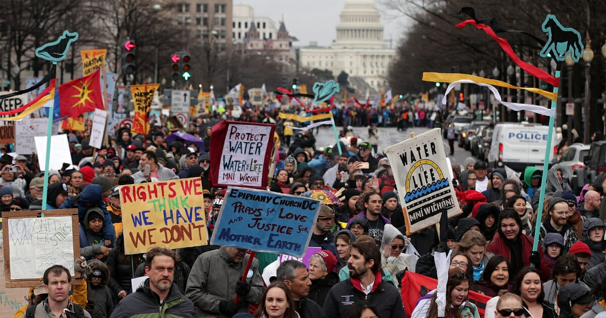 Protesters march in front of Capitol Hill to protest the Dakota Access pipeline
